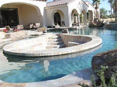 I think that is a pit for a fire pit - in the MIDDLE of the swimming pool? Somewhere in Austin.