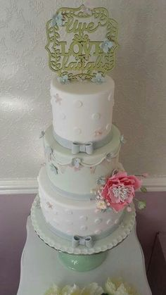 Vintage mint and sage green wedding cake with open pink peony and bunting by Corr's Cakes