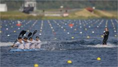 Britain's under-23 rowing team pull a wakeboarder during a display before the canoe sprint events at Eton Dorney