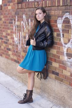 Love this jade dress with the leather jacket and combat boots.