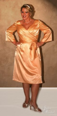 Click here: http://www.jalisbridal.com/full-collection/bridesmaid/paloma.html $159...Great bridesmaid dress for our more mature ladies. It is an incredible 3/4 knee length gown with 3/4 length sleeves and a bow around the waist for that perfect look
