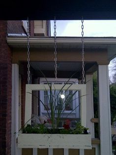 Hanging Window Box Planter made from an old window and reclaimed wood.