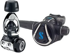 This SCUBAPRO regulator is high performance but it's also light to travel with. The first stage is compact and has plenty of attachment points, it comes with a yoke (or A-Clamp) tank attachment and a rubber hose. Check out our complete list for the most lightweight scuba gear for female divers! #TravelFashionGirl #TravelFashion #PackingTips #scubadivinggear #wateradventure #scubadivingaccessories Dive Bag, Scuba Diving Gear, Packing List For Travel, Packing Light, Travel Luggage, Computer, Travel Accessories, Travel Style, Compact