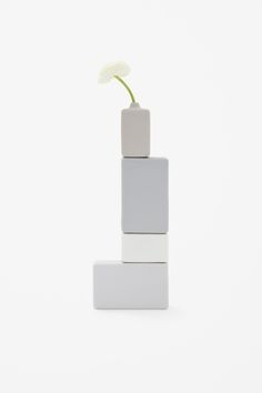 block vase by Nendo for  for 1% A set of small bud vases that can be stacked together like building blocks. The vase comes in four differe...