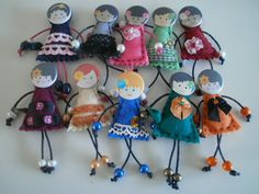 These dolls would be darling done with quilled parts!