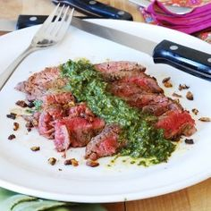 Flank steak and Chimichurri sauce....I added half a bunch of cilantro to this and it was so good!  We put it on the roasted potatoes and shrimp we had too.  Delish!