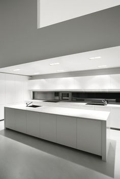 - Recessed ceiling lights from Panzeri Recessed Ceiling Lights, Modern Kitchen Cabinets, White Backdrop, Contemporary Interior Design, White Cabinets, Cabinet Doors, Home Remodeling, Countertops, Living Spaces