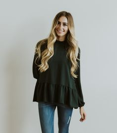***Will be RESTOCKING in 2 weeks (10.5.16) Sign up for the product restock notification by selecting your size below***Model is 5'8 wearing size SMALLDeep forest green color with ruffle neck, and ruffle cinched sleevesHas a small clasp at the back of the neck with keyholeFits TTSPolyester blend fabric