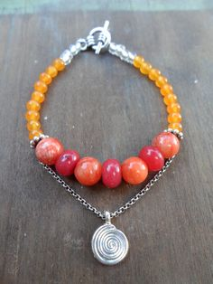 This bracelet was handmade using a beautiful variety of vibrant Jade Gemstone beads & specially charged with Healing Reiki Energy.