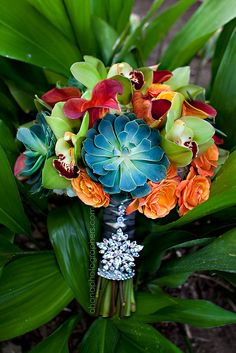 orange and green orchid and succulent tropical wedding bouquet with bride's grandmother's brooch // bahia resort hotel san diego wedding