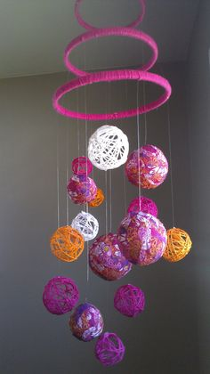 Baby mobile. want to copy the embroidery hoops and yarn...butterflies instead of balls thought...