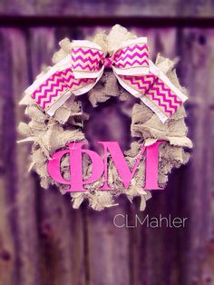 Maybe try to replicate this (with last name initial)... Phi Mu Sorority burlap wreath by CLMahler on Etsy
