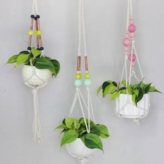 Three colorful hanging planter ideas made with copper pipe and colored beads!