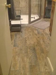 Our remodeled bathroom floor. Ceramic tile that looks like wood!