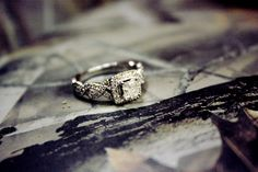 wedding ring with the infinity sign on the sides and camo background