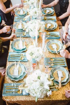 Aqua and glittery gold table setting. For me, there are too many flower arrangements on the table. Otherwise, I like the table setting. Remember less is more. JH