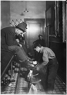 Shoeshiner by Lewis Hine