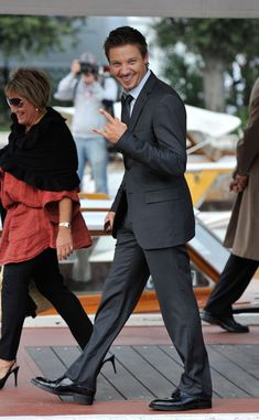 Jeremy Wearing White Button-Up Shirt, Dark Tie and Gray Suit Arriving At The Venice Film Festival