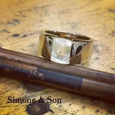 Check out this custom men's ring! Clean #modern lines in 18k white gold accent this unique light yellow sapphire center stone. #simoneandson #sapphire #mensjewelry #mensring #orangecounty