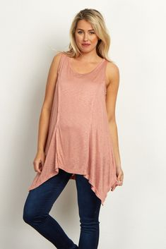 This flowy maternity top is perfect for the boho lover. A solid asymmetric tank top that will keep you cool while giving you a trendy and simplistic style. Pair this tank with maternity jeans and boots for a chic look.
