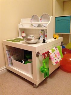 The finished play kitchen/ workbench hack made from an ikea lack table! I added a wall towel rail/ shelf unit fitted upside down to make the plate & cup storage bit on the kitchen side and space for hanging tool storage on the workbench side Diy Kids Kitchen, Ikea Play Kitchen, Toy Kitchen Set, Play Kitchens, Ikea Lack Table, Lack Table Hack, Lack Hack, Kids Workbench, Plan Toys