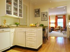 kitchen to living room, wood floor, wall color, orange drapes