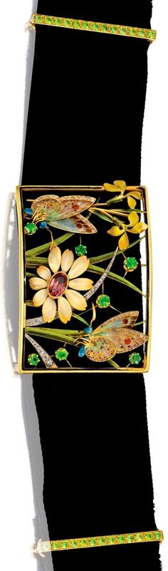 Henri Dubret - An Art Nouveau gold, coloured stone, diamond and enamel collier de chien, French, circa 1900. The centre plaque depicting two butterflies among flowers and grass, applied with multi-coloured enamel, set with round demantoid garnets and orange garnets, accented by rose-cut diamonds, completed by a black velvet choker accented by gold spacers set with round demantoid garnets, centre plaque signed H. Dubret, maker's mark, French assay marks.