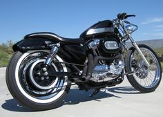 Image of 1998 Sportster Bobber with 1200cc Harley Evo Engine and black wrapped exhaust pipes.