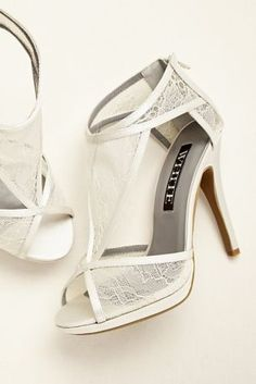 Lace wedding shoes. White by Vera Wang for David's Bridal.