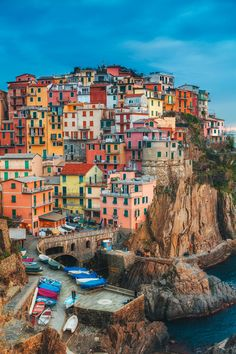 """Late afternoon overlooking the beautiful fishing village of Manarola, Cinque Terre.  The Cinque Terre is a rugged portion of coast on the Italian Riviera. It is in the Liguria region of Italy, to the west of the city of La Spezia. """"The Five Lands"""" is composed of five villages: Monterosso al Mare, Vernazza, Corniglia, Manarola, and Riomaggiore. The coastline, the five villages, and the surrounding hillsides are all part of the Cinque Terre National Park and is a UNESCO World Heritage..."""