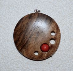 Chestnut and coral pendent