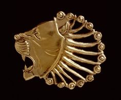 Golden and silver cloak pin in the shape of a lion head. Most often these pins are made and used as twins. It is 5.3cm in height. Found in Iran. 400 BC. Source: Leiden Museum of Antiquities