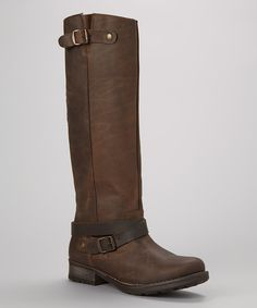 Nothing says attitude like a snazzy boot, and this leather beauty is no exception. With ankle-wrapping straps and a stable, modest heel, it makes for confident and sassy steps.1.25'' heel12.25'' shaft14'' circumferenceBack zip closureLeather upper