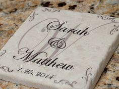 Tumbled stone coasters are personalized with bride and grooms first name, wedding date and family initial.  Great and unique wedding gift.   #weddingcoasters