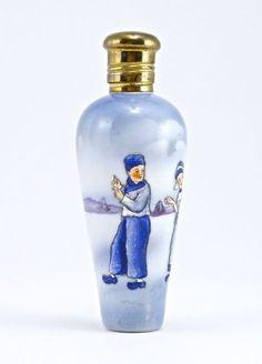 1900s European scent bottle, enameled porcelain, relief molded figures, metal screw cap. 3 1/2 in.