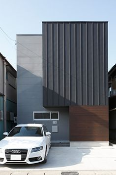 black siding mixed with wood and cement block