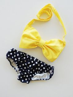 yellow bow top bikini and polka dot bottoms.