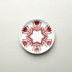 Kate Forrester's folkloric design adds tulips to a stylized snowflake - Crate & Barrel Christmas 2015