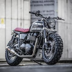 For extroverts only: this new Triumph T100 from @downandoutcaferacers has a truckload of attitude. The stance is belligerent, helped by the chunky Continental Twinduro TKC80 rubber—one of the few dual sport tires that perform well on pavement. There's no way that sort of rubber would normally fit between the forks of a standard T100. But builders Shaun and Carl have neatly solved that problem, by installing Honda CBR1000RR (Fireblade) forks and a set of custom triple trees. Hit the link i...