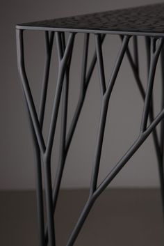 "Arborism --- is a table which has tree form arms. The design of the unique arms has been configured by the fractal algorithm called ""Tree Curve."" So the design is as same as the branch structure of a real tree.  The interesting point of this design is that it was completed not by the arbitrary work of the designer but by the natural logic of nature itself."