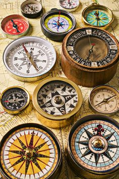 Assorted compasses Photograph  - Assorted compasses Fine Art Print