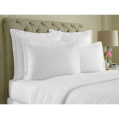 Finish your bed with sophistication with the Double Flange Pillow Sham from Wamsutta. This pillow sham features luxurious, glistening 100% cotton sateen delicately layered with meticulously tailored double flange embellishments.