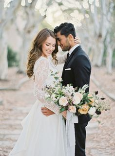 Old World Romance Wedding Inspiration | Floral by Gavita Flora | Photo by Hannah Suh | Once Wed Feature | Lace Wedding Dress Sleeves | Outdoor Couples Wedding Pictures