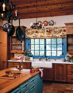 French Country Kitchen - Really warm and cozy!  I like the blue accents around the window and the blue island.