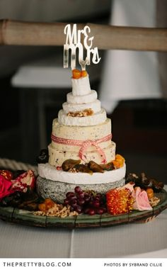 Cheese wedding cake decorated with fresh fruit & flowers | Photographer: Sybrand Cillie, Wedding Coordinating: Blomlief