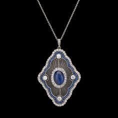 Blue Sapphire and Diamond Pendant/Brooch, circa 1915.