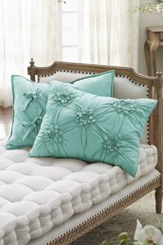 Beautiful Turquoise #Pillows.  Fun embroidered fabric detail.  I love Interior Design. White French Style Settee. pretty pillows. Live Beautifully!