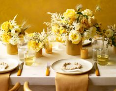 nice yellow and white centerpieces with beeswax sheets wrapped around container