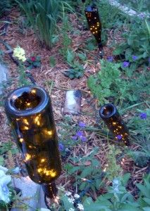 Wine Bottles + White Lights = Cool Garden Lights
