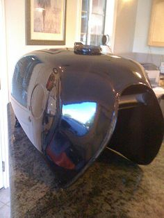 Motorcycle gas tank powdercoated with a translucent dark blue powder coating.